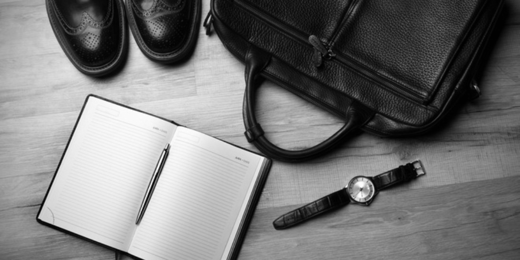 Image of business items and notebook to portray how to get others to read your employee handbook