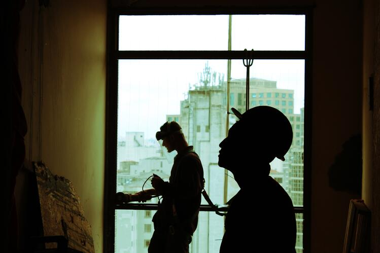 Image of two workers standing on job site to illustrate workplace safety